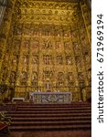 Small photo of SEVILLE, SPAIN - OCTOBER, 2016: Cathedral La Giralda - architecture religion background. View of interior of the Cathedral of Seville. Close up of altarpiece (Pierre Dancart's masterpiece)