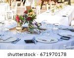 outdoor wedding celebration at... | Shutterstock . vector #671970178