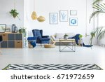 spacious living room with sofa  ...   Shutterstock . vector #671972659