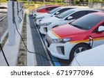 electric car charging... | Shutterstock . vector #671977096