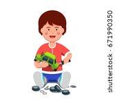smiling little boy mechanic...   Shutterstock .eps vector #671990350