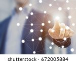 person touching a network chart ... | Shutterstock . vector #672005884