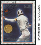 Small photo of RUSSIA KALININGRAD, 19 APRIL 2017: stamp printed by Paraguay, shows Ania Fichtel, gold medalist at Seoul, circa 1989