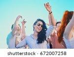 caucasian girl dancing and... | Shutterstock . vector #672007258