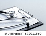 empty doctor workplace with a... | Shutterstock . vector #672011560