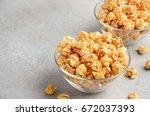 homemade caramel popcorn ... | Shutterstock . vector #672037393
