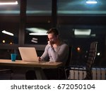 young man working on laptop at... | Shutterstock . vector #672050104