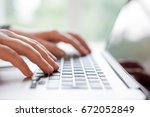 hands with laptop typing  | Shutterstock . vector #672052849