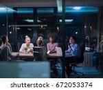 multiethnic startup business... | Shutterstock . vector #672053374