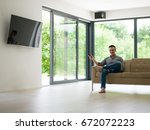 young handsome man enjoying... | Shutterstock . vector #672072223