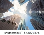 upward view of skyscrapers... | Shutterstock . vector #672079576