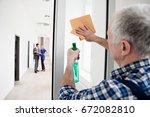 man cleaning window | Shutterstock . vector #672082810