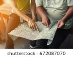 young traveler pointing map and ... | Shutterstock . vector #672087070