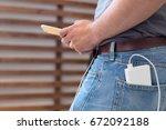 smartphone charging with power... | Shutterstock . vector #672092188