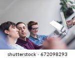 business team meeting in modern ... | Shutterstock . vector #672098293