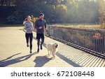 Stock photo fitness sport people and jogging concept happy couple with dog running outdoors 672108448