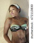 girl in bikini laying on sand ...   Shutterstock . vector #672113830