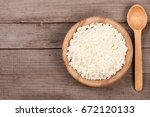 cottage cheese in a wooden bowl ...   Shutterstock . vector #672120133