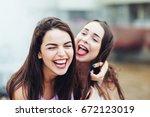 two beautiful girlfriends...   Shutterstock . vector #672123019