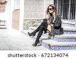 beautiful young woman wearing... | Shutterstock . vector #672134074