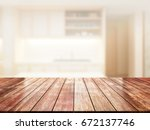 closeup top wood table with... | Shutterstock . vector #672137746