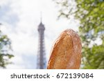 french baguette against eiffel... | Shutterstock . vector #672139084