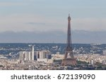 cityscape of paris with eiffel... | Shutterstock . vector #672139090