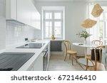 white kitchen in scandinavian... | Shutterstock . vector #672146410