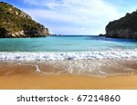 A view of Paleokastritsa beach on Corfu, Greece, one of the Island's most popular resorts. - stock photo