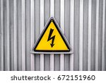 high voltage yellow triangle... | Shutterstock . vector #672151960