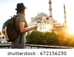 a young beautiful traveler girl ...   Shutterstock . vector #672156250