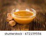 portion of fresh caramel sauce  ... | Shutterstock . vector #672159556