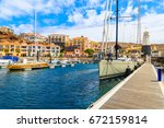 Sailing Boats In Port With...