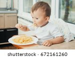 the child eagerly eats... | Shutterstock . vector #672161260