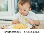 the child eagerly eats... | Shutterstock . vector #672161266