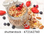 homemade granola with berries | Shutterstock . vector #672162760