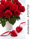 Stock photo red roses in vase and hearts for valentine s day 67217710