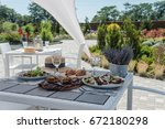 white table on the street in a... | Shutterstock . vector #672180298