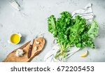 fresh wet raw green kale leaves ... | Shutterstock . vector #672205453