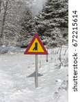 "Small photo of Sign ""Adjacent secondary road"" on a winter day on a mountain road"