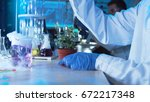 chemist doing tests in a... | Shutterstock . vector #672217348