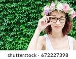 Small photo of girl with visual disturbance tries to look through the glasses