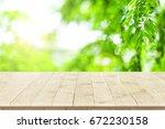 empty wooden table perspective... | Shutterstock . vector #672230158