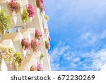 the balcony of the building has ... | Shutterstock . vector #672230269
