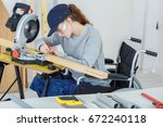 disabled female worker in... | Shutterstock . vector #672240118