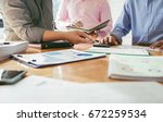 business colleagues meeting to... | Shutterstock . vector #672259534