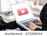 woman showing a movie playback... | Shutterstock . vector #672283414