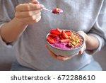 eating healthy breakfast bowl.... | Shutterstock . vector #672288610