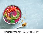 acai smoothie bowl with chia... | Shutterstock . vector #672288649