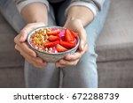 eating healthy breakfast bowl.... | Shutterstock . vector #672288739